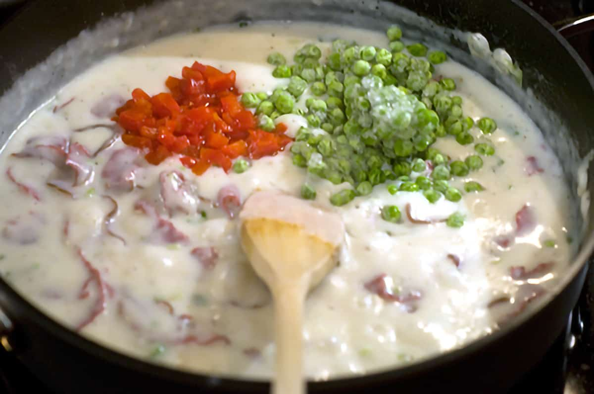 Peas and pimientos added to mixture in skillet.
