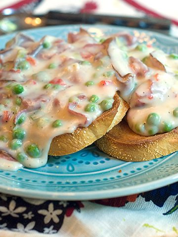 The most iconic of all military meals - Creamed Chipped Beef is a delicious mixture of dried, chipped beef in a creamy sauce served over toasted bread. From @NevrEnoughThyme https://www.lanascooking.com/creamed-chipped-beef/
