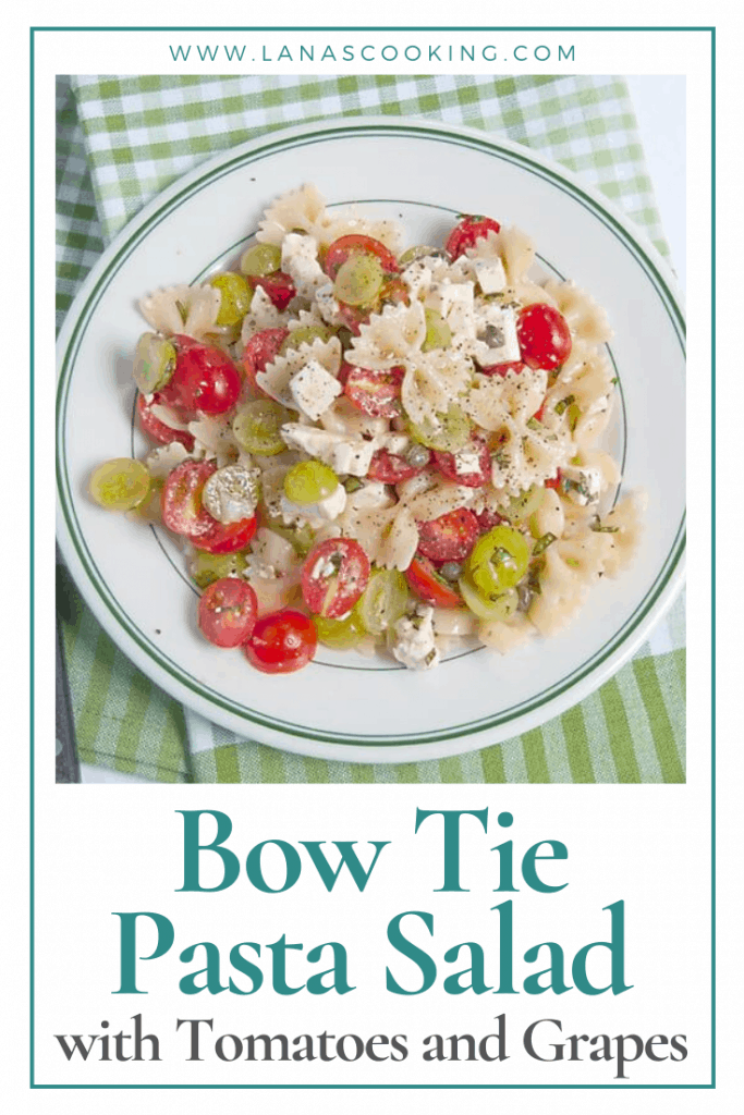 Bow Tie Pasta Salad with Tomatoes and Grapes - a surprising combination for a refreshing summery pasta salad. Great for a cookout or picnic! From @NevrEnoughThyme https://www.lanascooking.com/bow-tie-pasta-salad-with-tomatoes-and-grapes/