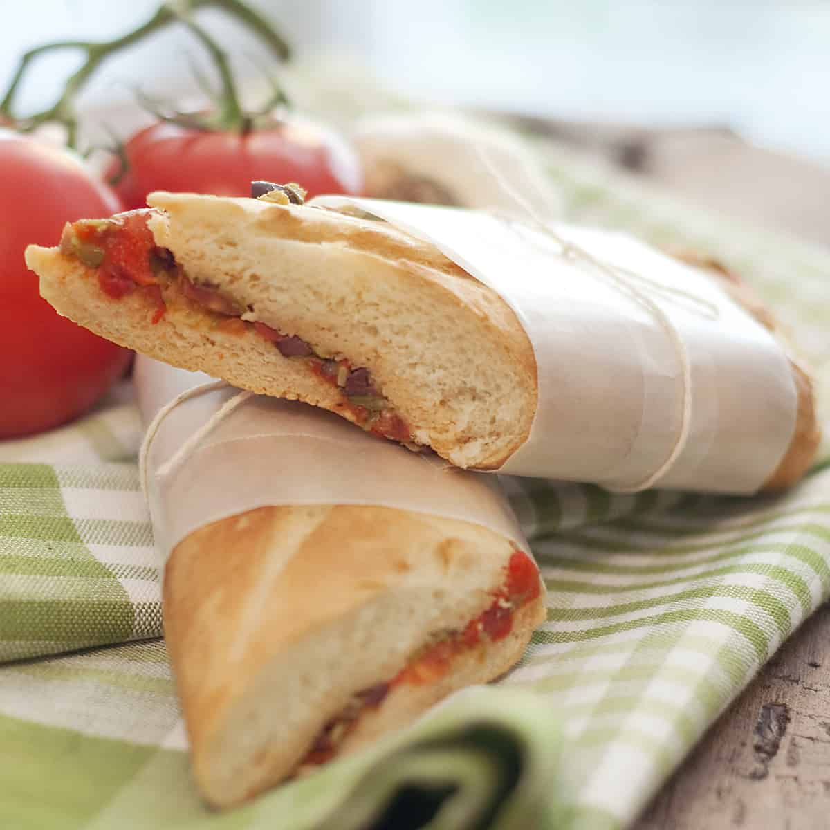 This Mediterranean Pressed Sandwich with its lovely bright flavors is just perfect for a late summer picnic. From @NevrEnoughThyme https://www.lanascooking.com/mediterranean-pressed-sandwich/
