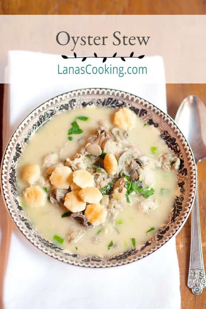 A serving of oyster stew in a bowl with a napkin and spoon alongside. Text overlay for pinning.