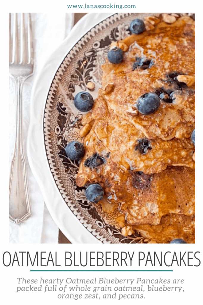 These hearty Oatmeal Blueberry Pancakes are packed full of whole grain oatmeal, blueberry, orange zest, and pecans. https://www.lanascooking.com/oatmeal-blueberry-pancakes/