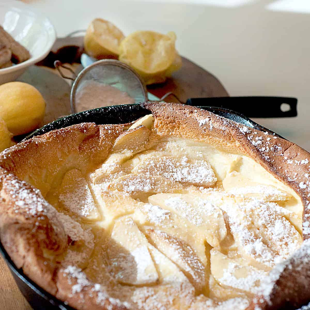 A light fluffy Dutch baby is just a big pancake cooked in the oven! Topped with lemon juice and powdered sugar, this breakfast treat is simply delicious. From @NevrEnoughThyme https://www.lanascooking.com/dutch-baby/