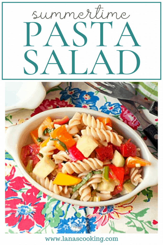 Summertime Pasta Salad - a cold pasta salad packed with fresh veggies and lightly dressed with a parmesan and garlic dressing. From @NevrEnoughThyme https://www.lanascooking.com/summertime-pasta-salad/