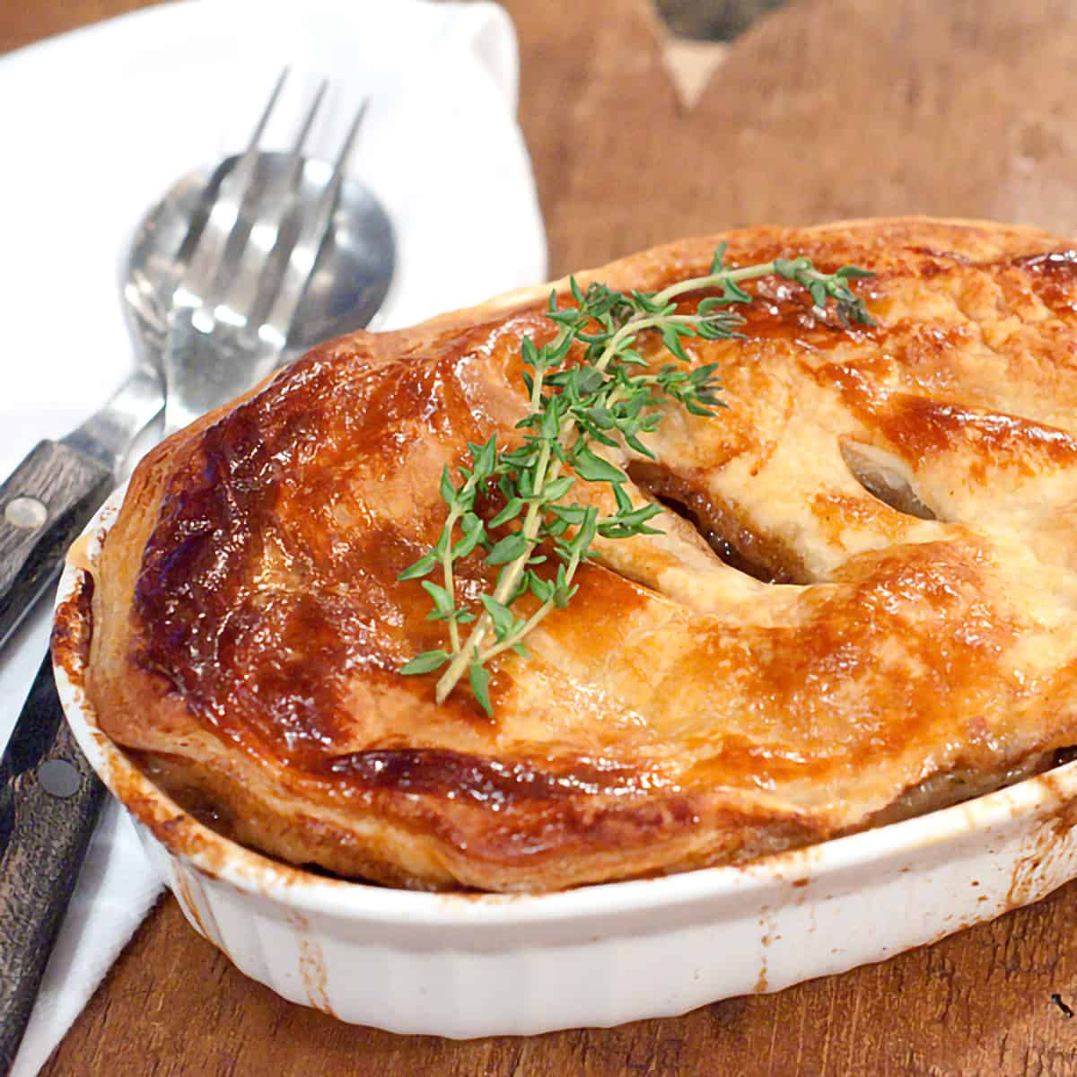 A rich, savory Beef and Stout pie with mushrooms and onions. Wonderfully comforting traditional Irish food. https://www.lanascooking.com/beef-and-stout-pie/