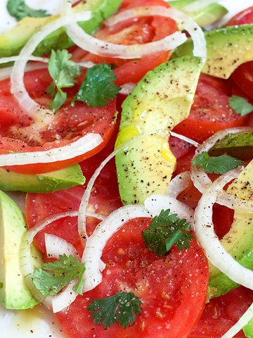 The very essence of summer! Light, refreshing, and healthy Tomato and Avocado Salad. 10 minute prep time. From @NevrEnoughThyme https://www.lanascooking.com/tomato-and-avocado-salad