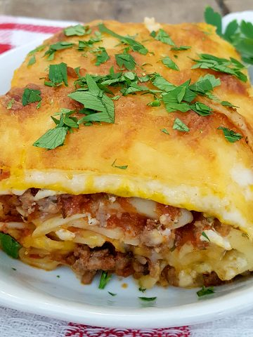 My Egg Noodle Lasagna recipe is a real family pleaser with layers and layers of meat sauce, cheesy filling, and egg noodles. https://www.lanascooking.com/egg-noodle-lasagna/