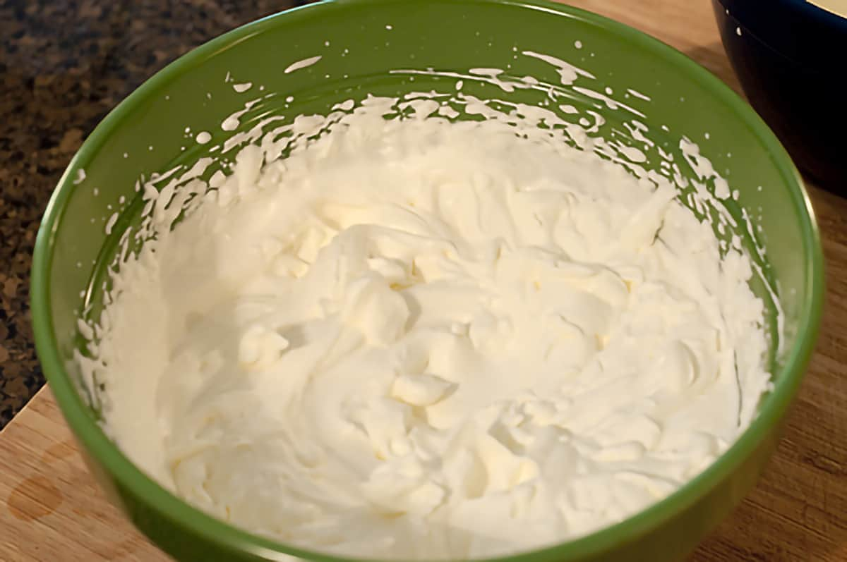 Large mixing bowl containing whipped cream