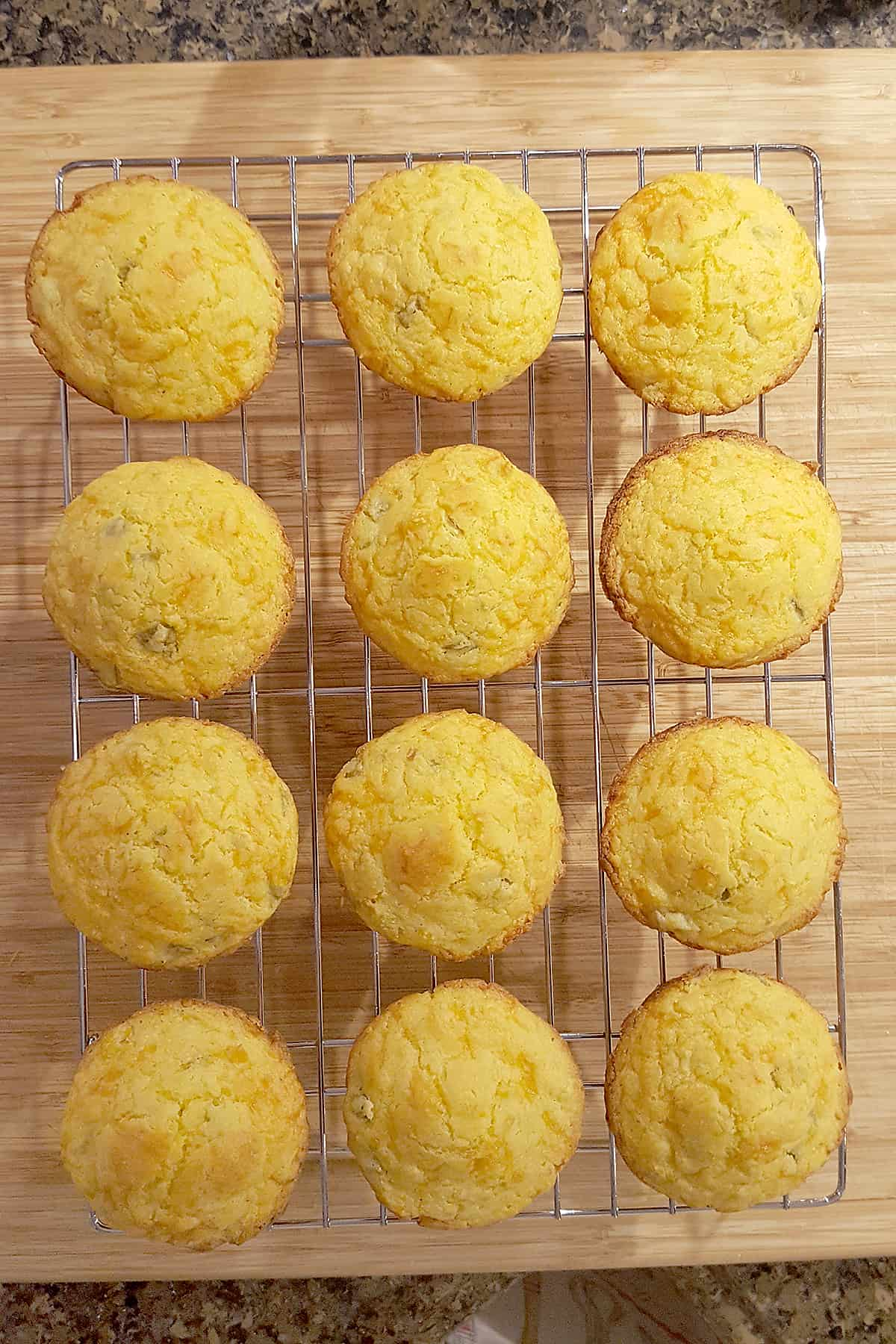 Green Chili Corn Muffins cooling on a wire rack.