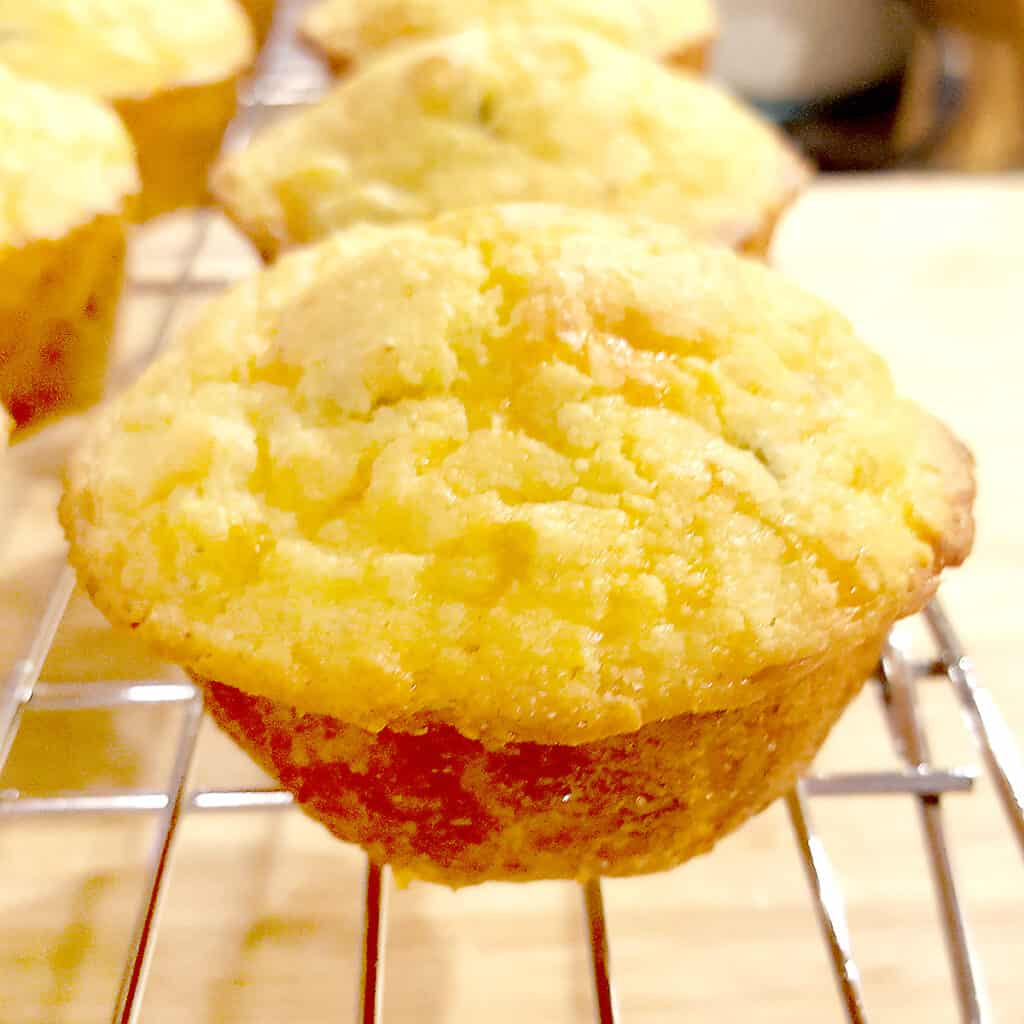 Green Chili Corn Muffins - moist corn muffins packed full of sharp cheddar and green chilis. Perfect with cool weather soups and stews. From NevrEnoughThyme https://www.lanascooking.com/chili-cheese-corn-muffins/