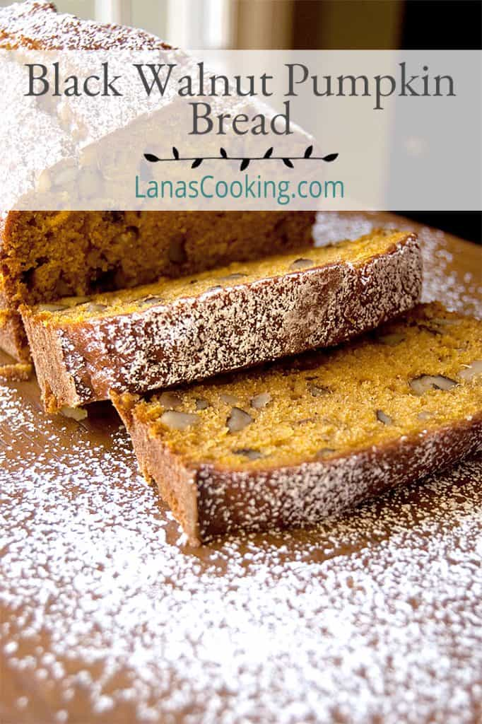 Sliced black walnut pumpkin bread on a serving board. Text overlay for pinning.