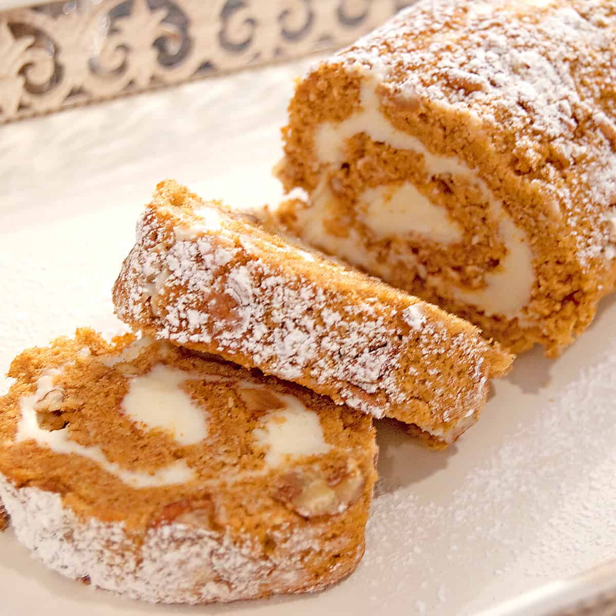 Slices of pumpkin roll on a serving tray.