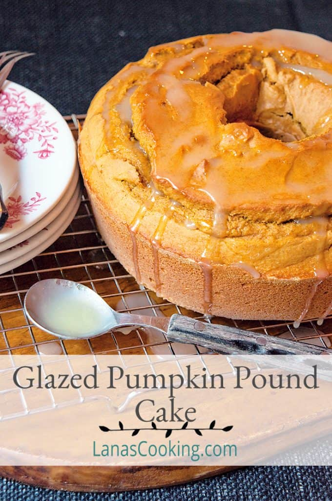 Pumpkin Pound Cake on a wooden board with a spoon and serving plates. Text overlay for pinning.