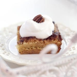 A slice of pumpkin crunch cake on a white serving plate.