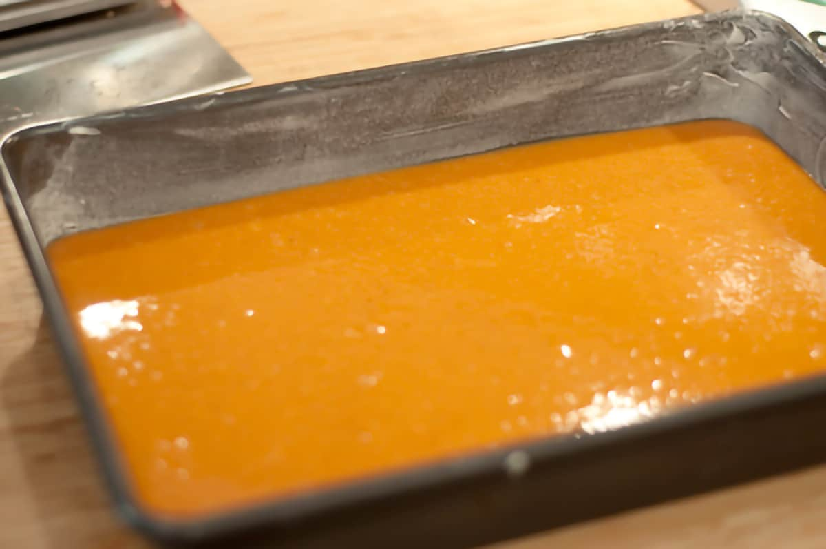 Wet ingredients poured into prepared baking pan.