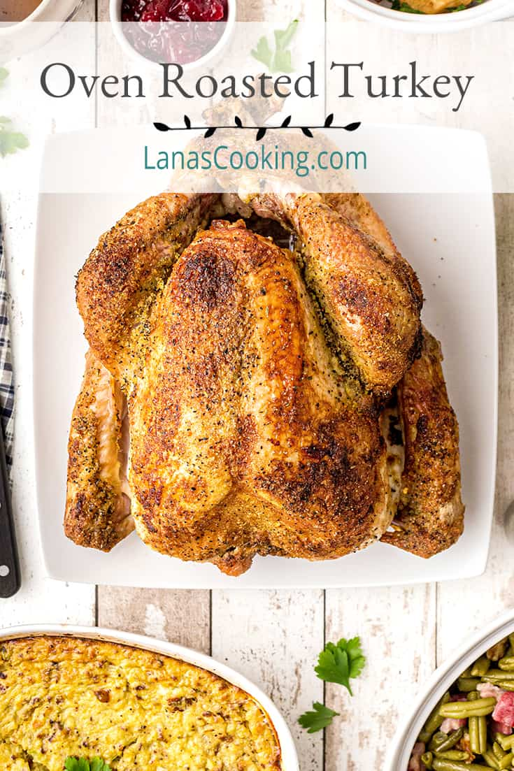 Oven Roasted Turkey with Gravy on a white serving platter. Text overlay for pinning.