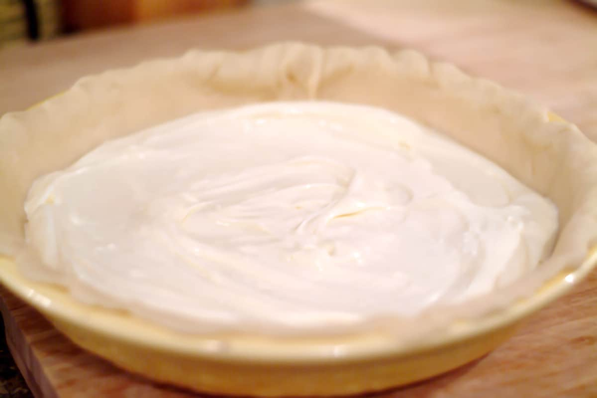 Cream cheese mixture poured into the pie crust.
