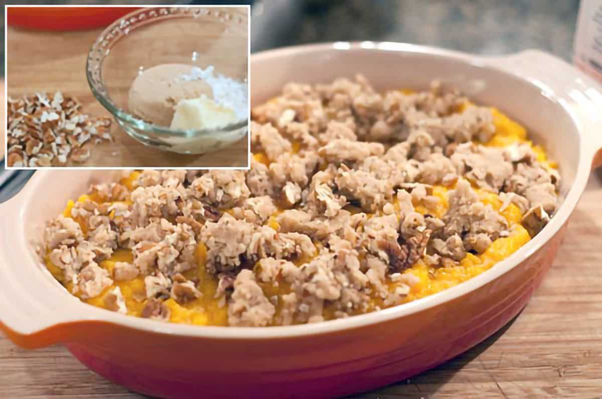 Sweet potato mixture in a baking dish with pecan-brown sugar mixture added to the top.