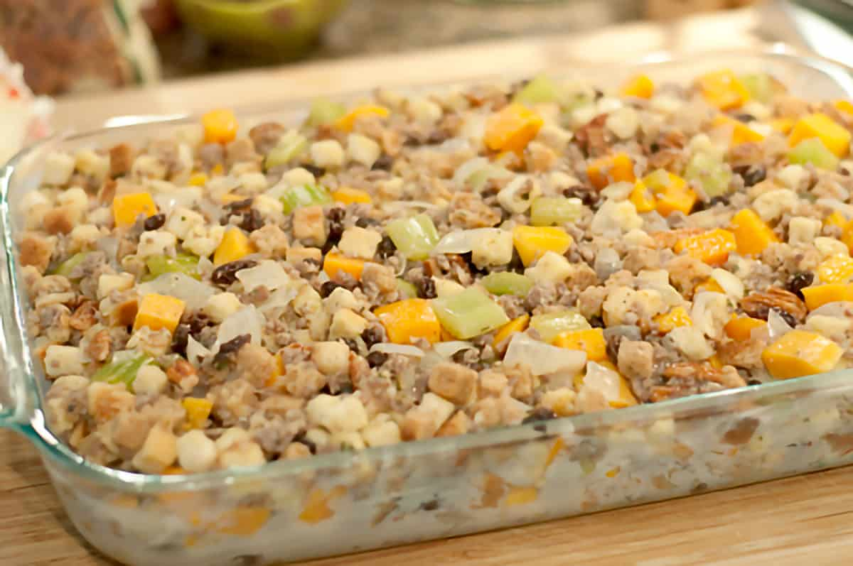 Finished Sweet Potato and Pecan Stuffing in a large baking dish ready to bake.