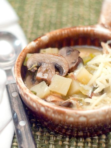 Turkey Mushroom and Potato Soup in a vintage serving bowl with a spoon.