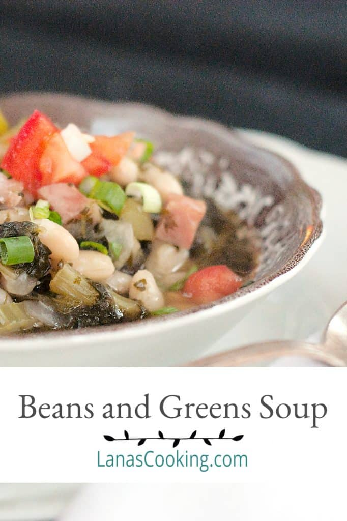 A bowl of Beans and Greens Soup with a spoon in the foreground. Text overlay for pinning.