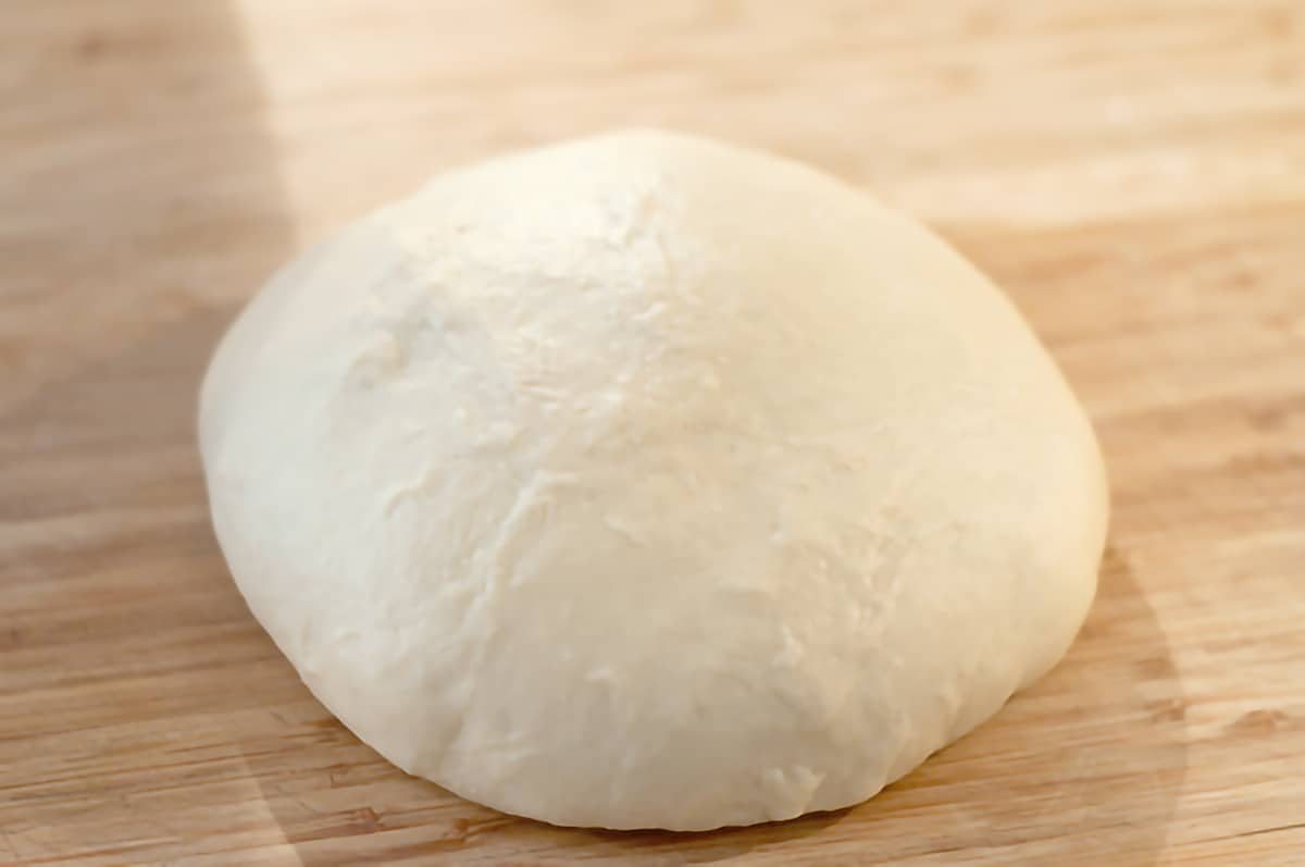 Kneaded dough formed into a ball.