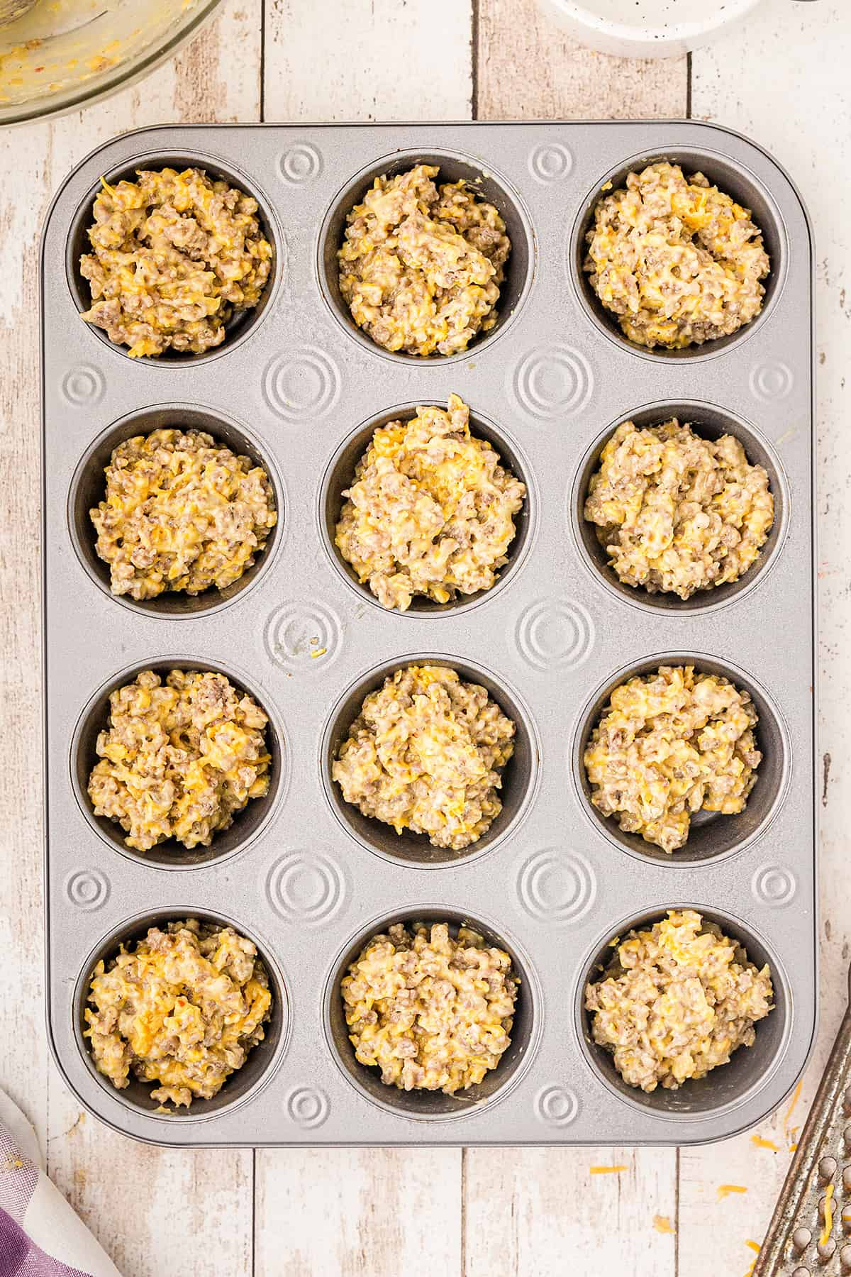 Muffin pan filled with recipe mixture.