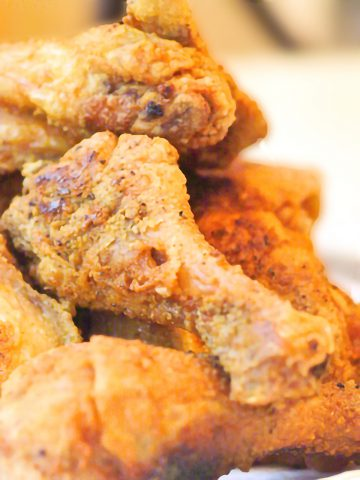 Finished fried chicken piled high on a serving plate
