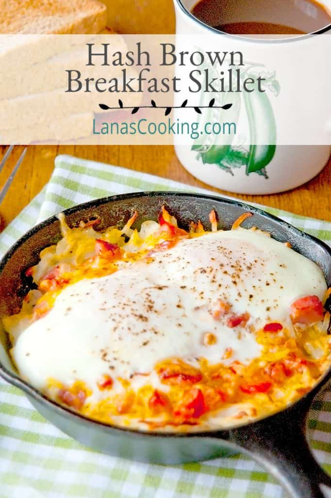 Hash Brown Breakfast Skillets on a kitchen towel with a cup of coffee in the background. Text overlay for pinning.