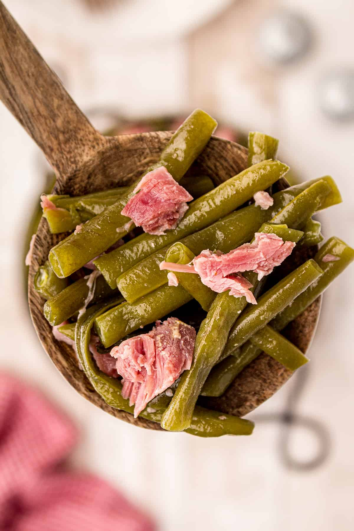Closeup of a wooden spoonful of Old Fashioned Southern Style Green Beans