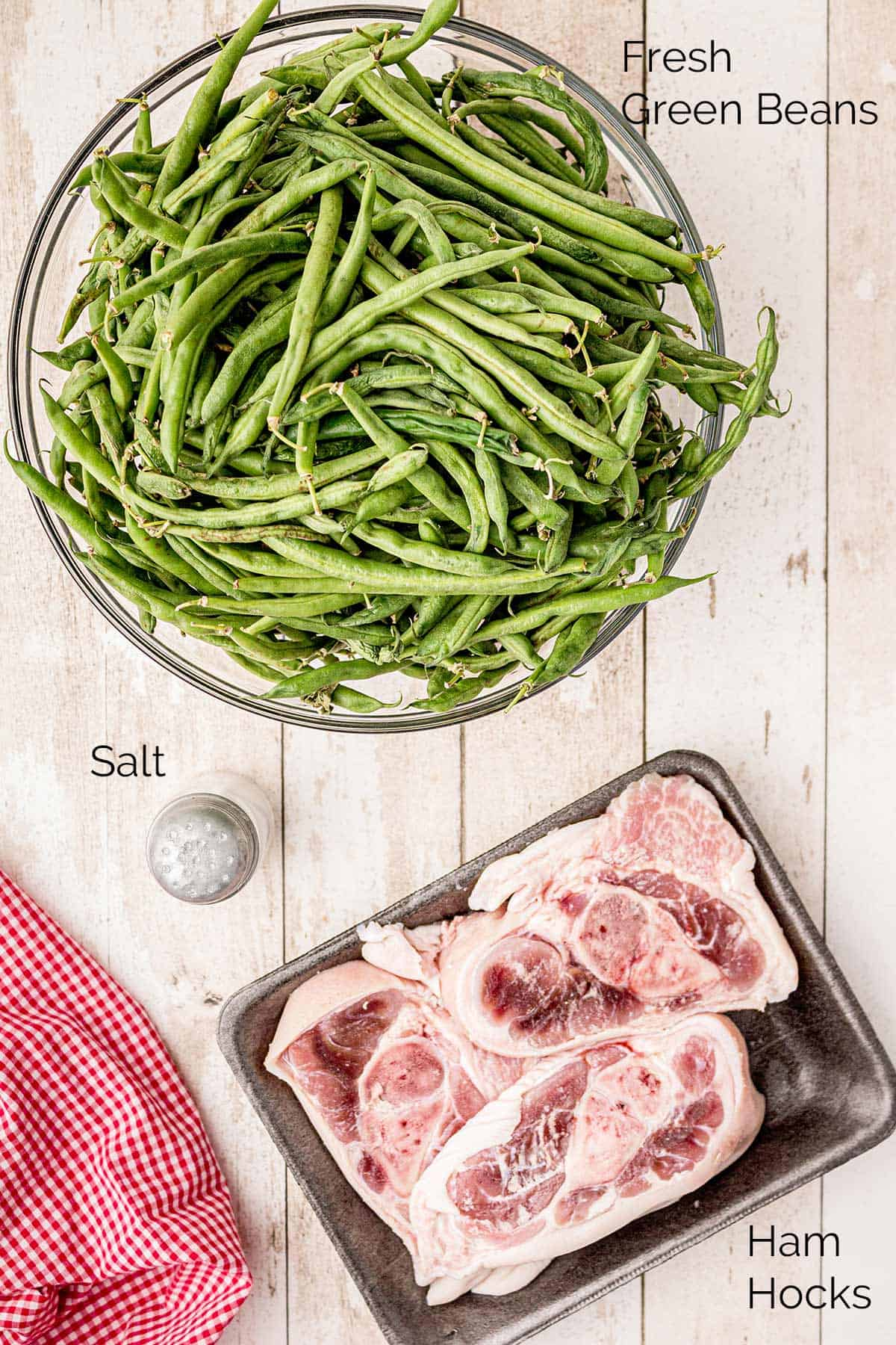 Photo of ingredients needed for the recipes: green beans, salt, ham hocks
