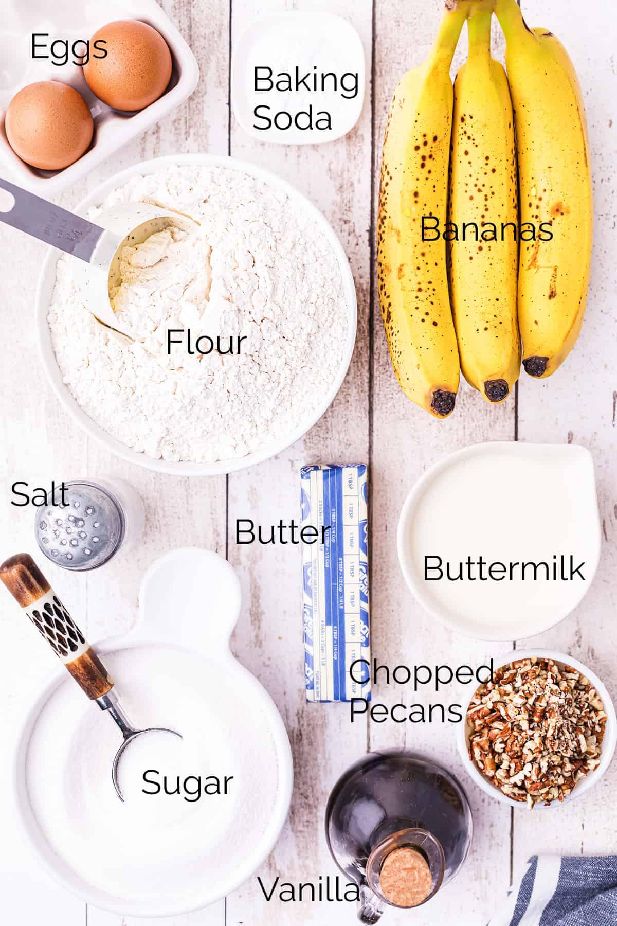 Ingredients needed for Buttermilk Banana Nut Bread: sugar, butter, eggs, flour, baking soda, buttermilk, bananas, pecans, salt, and vanilla extract.