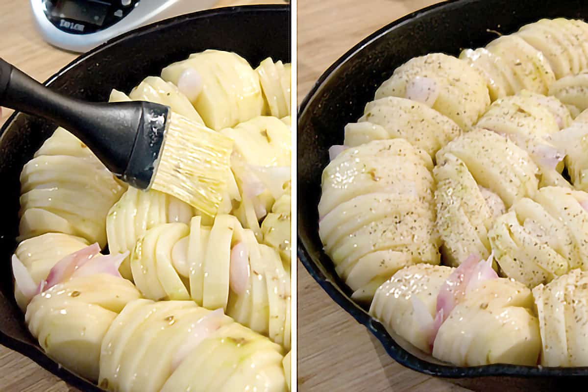 Potatoes and shallots in a cast iron skillet brushed with butter and sprinkled with salt and pepper.
