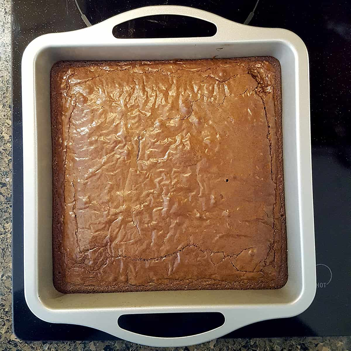 Baking pan containing cooked and cooled brownies.