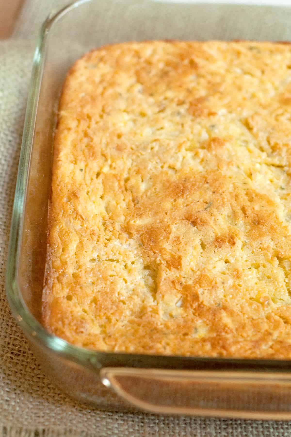 Finished squash and cornbread casserole in a baking dish.