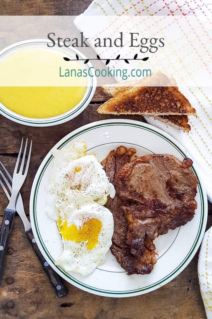 Steak and eggs on a serving plate with grits and toast on the side.