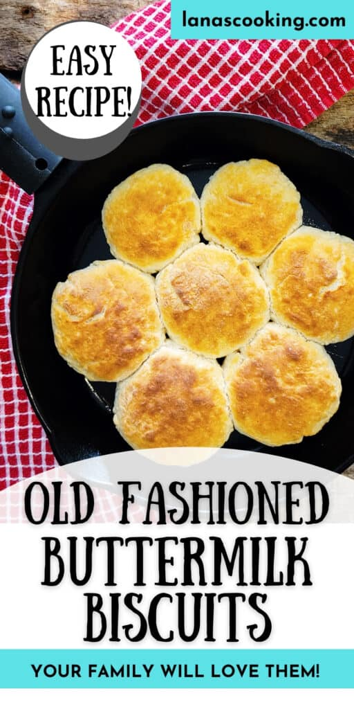 Baked buttermilk biscuits in a cast iron skillet on a wooden board.