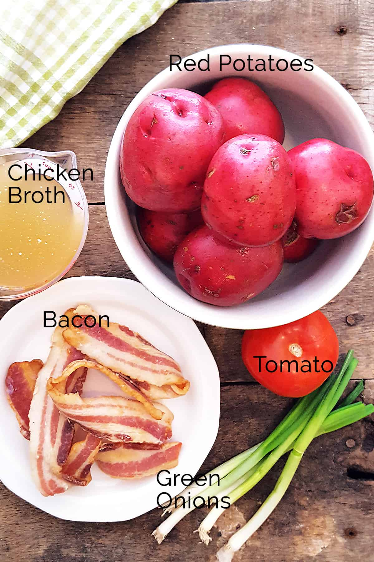 Ingredients needed for the recipe: chicken broth, red potatoes, tomato, green onions, bacon