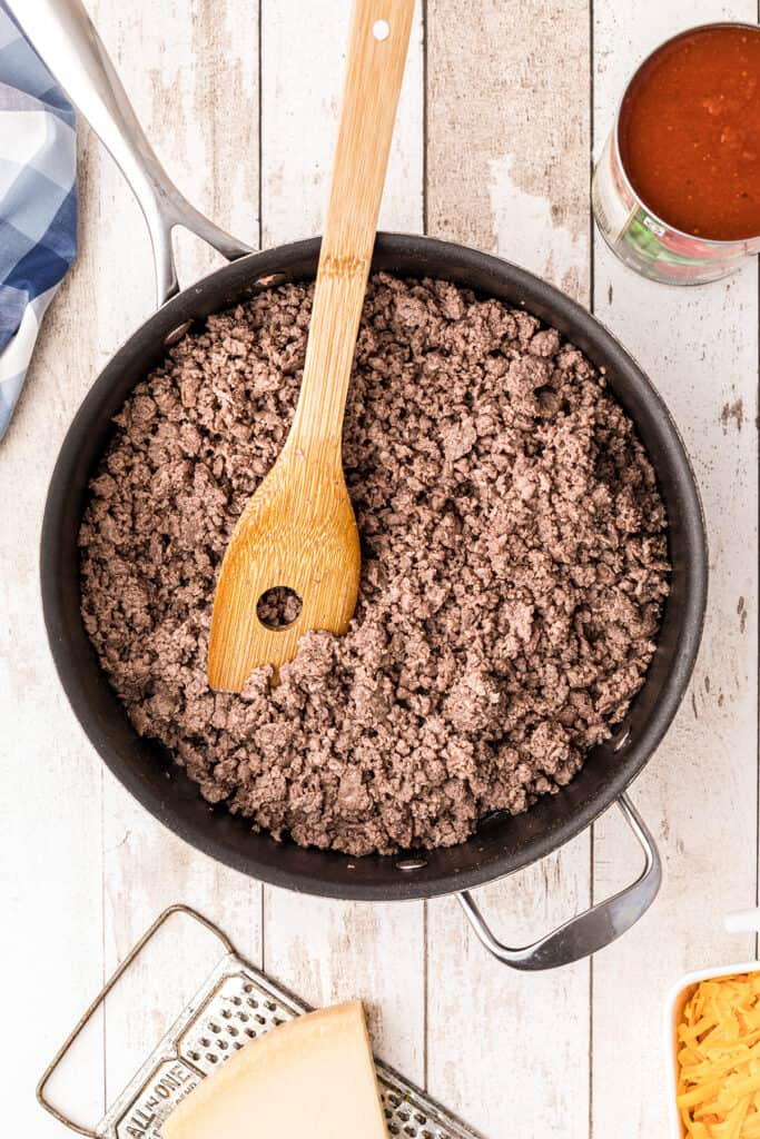 Ground beef browning in large skillet.