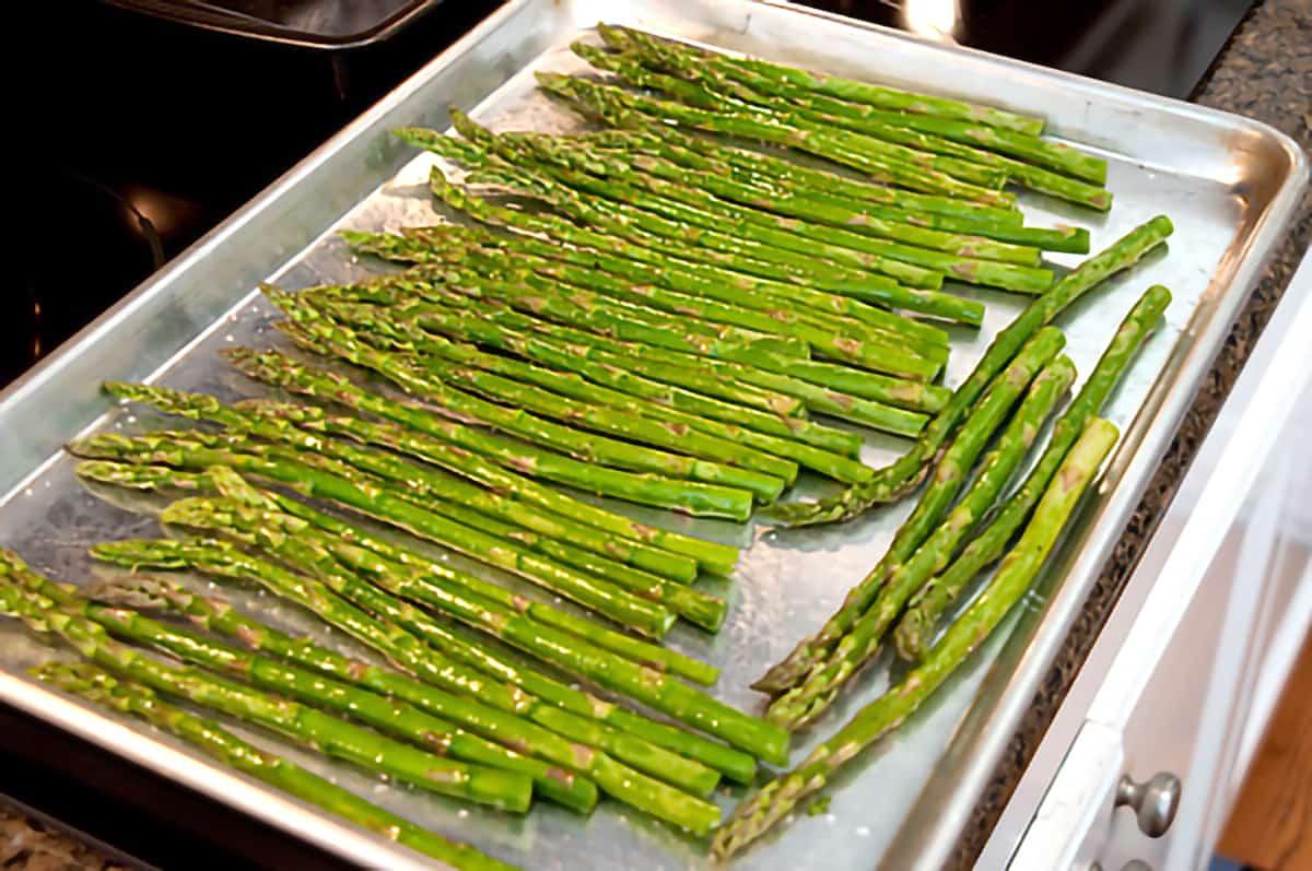 Asparagus on a baking sheet.