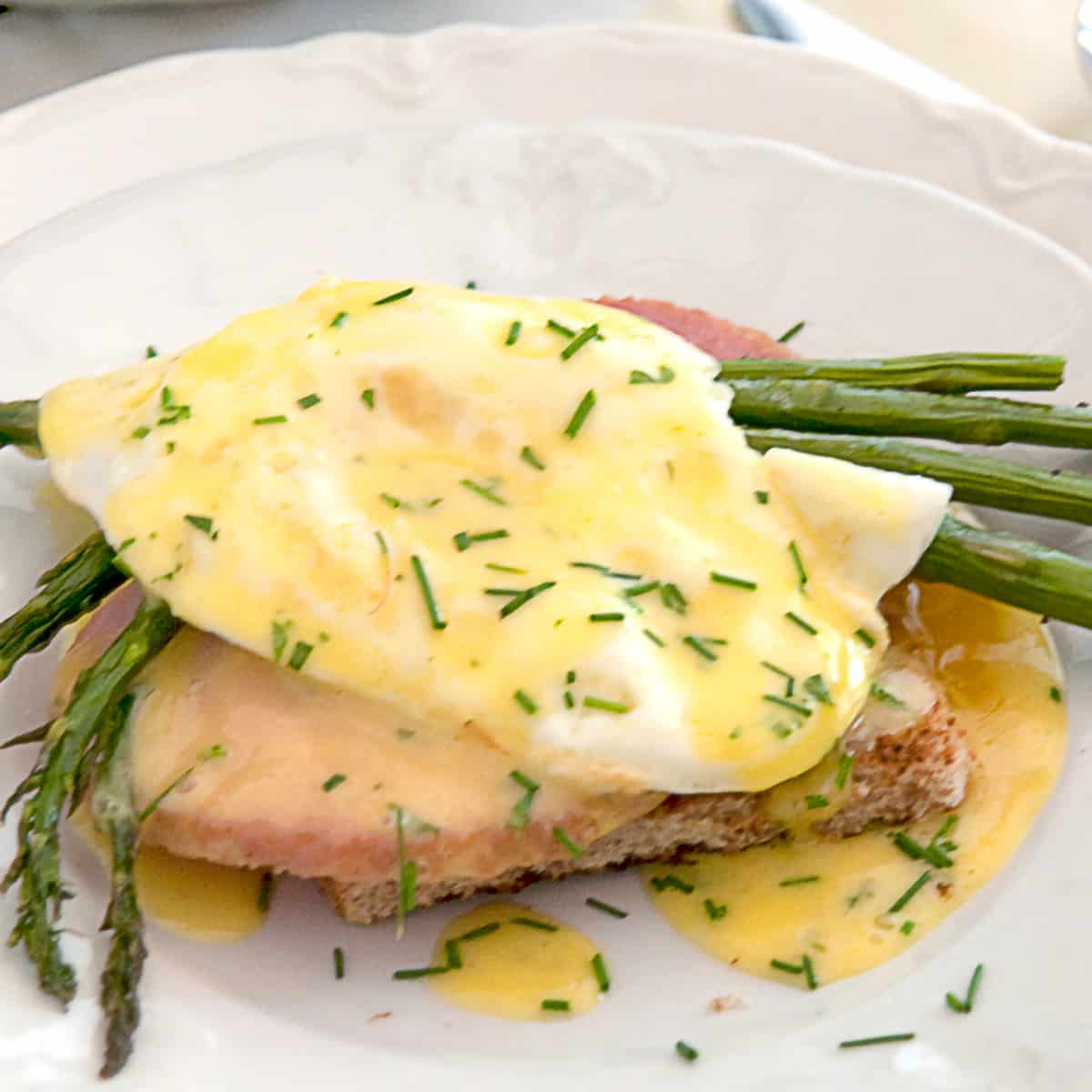 Country eggs benedict on a white serving plate.