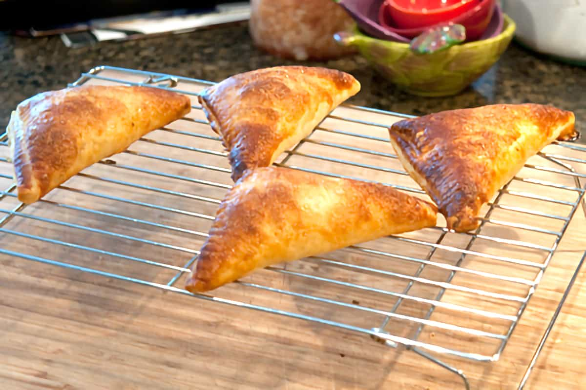 Baked pastries on a cooling rack.