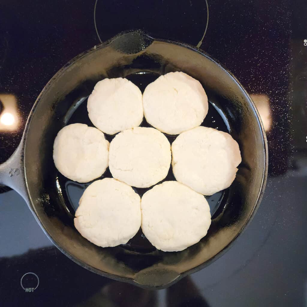 Formed biscuits in a cast iron skillet.