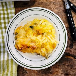 A serving of copycat cracker barrel hash brown casserole on a plate.