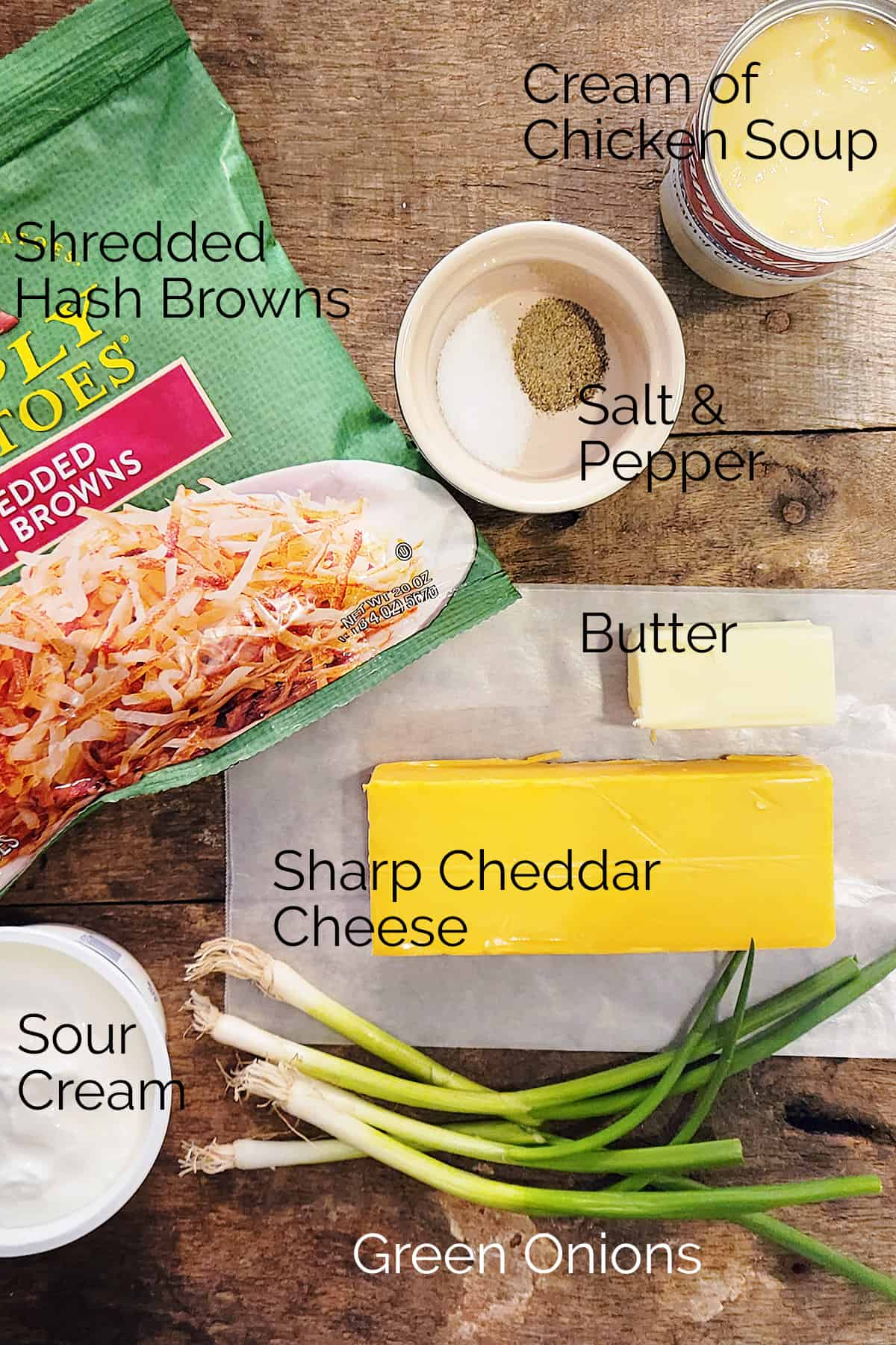 Ingredients needed for the recipe -- shredded hash browns, cream of chicken soup, salt, pepper, butter, cheese, green onions, sour cream.