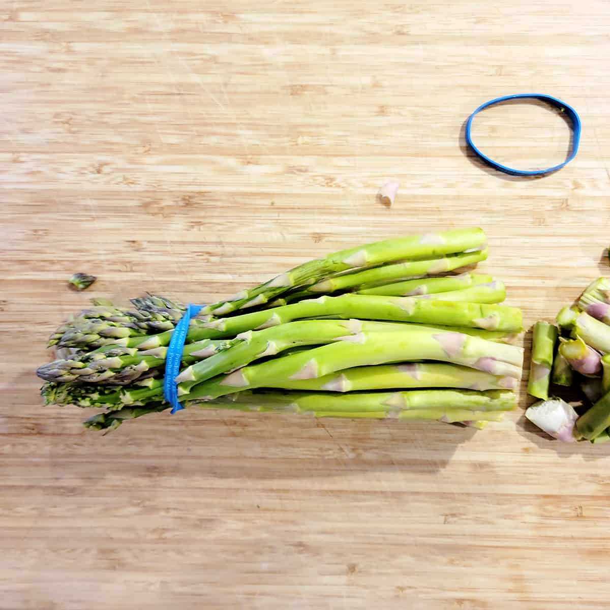 A bundle of fresh asparagus with the ends trimmed