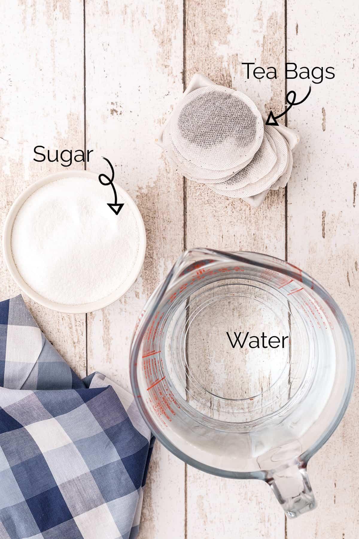 Ingredients needed to make sweet tea -- sugar, tea bags, water.