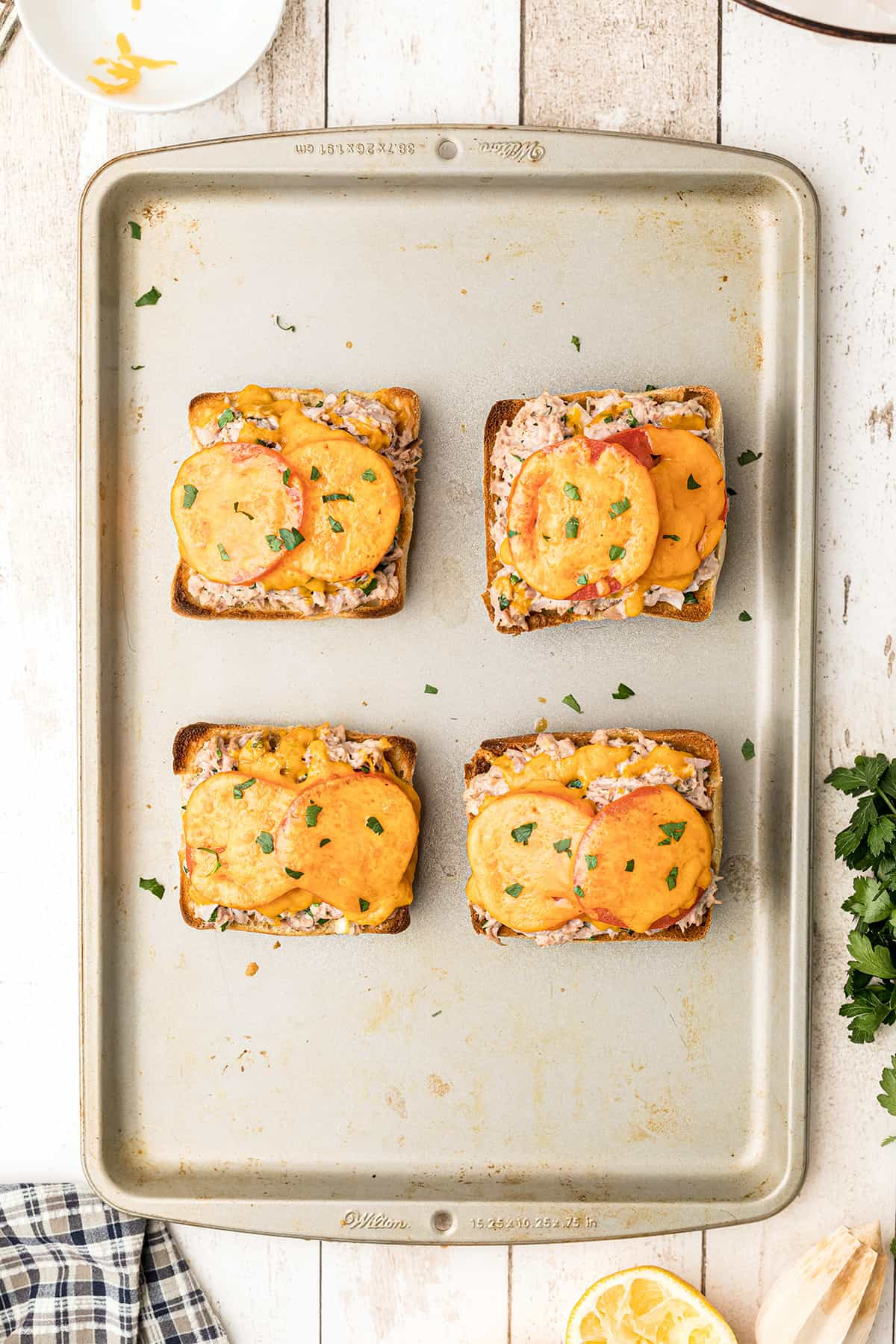 Finished sandwiches on a baking sheet.