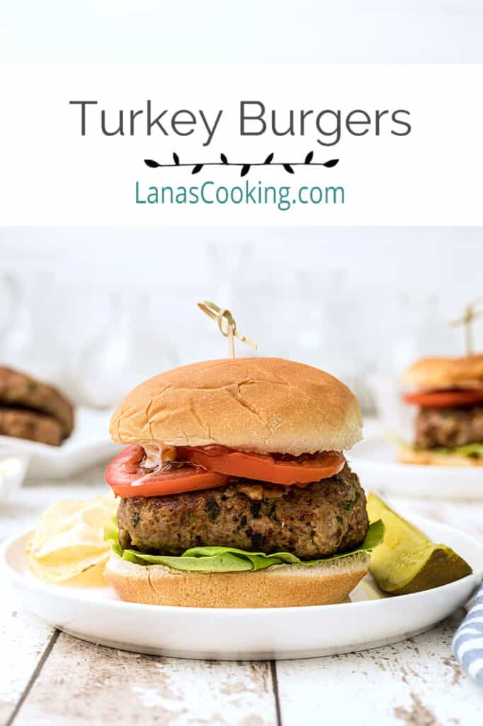 Finished turkey burger on a white serving plate.