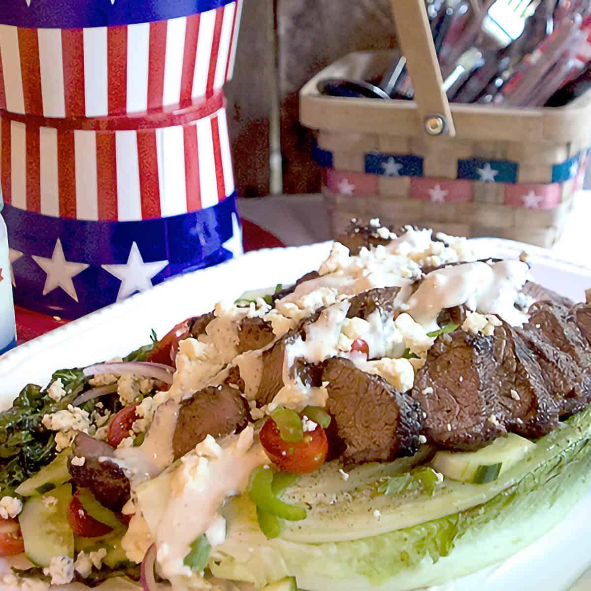 Grilled steak salad on a large white platter.
